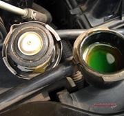 green radiator liquid inside radiator cap