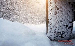 Car Tire in Snow