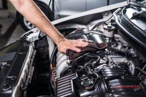 mechanic cleans a car engine