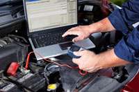 mechanic performs electrical diagnostic test on car